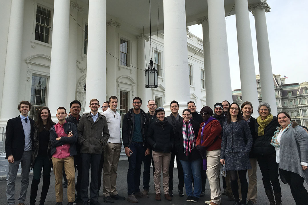 A large group of LGBT spring 2017 residency attendees standing outside in front of a DC building