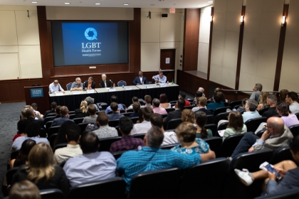 "Panelists and attendees at a GW discussion, ""Getting the Word Out: Stonewall, the Power of Information and LGBTQ Health."""